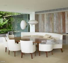 interior dining table with curved bench seating and chairs with