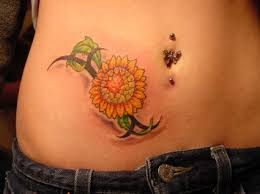 tribal and realistic sunflower tattoo on right hip