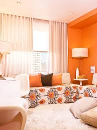 orange bedroom curtains living room floral pattern sofa orange accent wall white