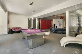lower level in luxury home with pool table stock photo picture