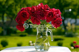 pitcher of roses glass pitcher with roses in the garden stock photo thinkstock