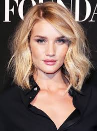 rosie huntington side parted lob 3 flattering haircuts to make your face look thinner lob