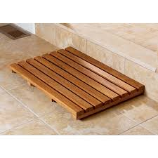 wood shower mat give a accent to your bathroom