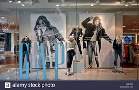 gap clothing store window display featuring female clothing