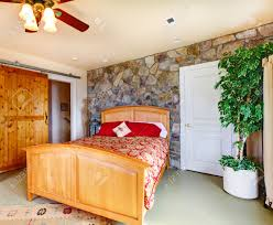 Bedroom Bed In Corner Exotic Bedroom Interior With Stone Wall Trim Wooden Bed And