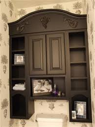 classic bathroom with dark brown wooden cabinet and eight square