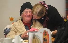 volunteer bonnie carroll hugs nancy thompson at the santa barbara