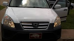 headlight bulb replacement service 2005 honda cr v high and low
