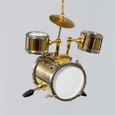 3 shiny gold brass and white drum set musical instrument