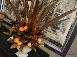 Centerpiece With Feathers by A Fall Centerpiece Of Magnolia Leaves And Feathers Celebrate