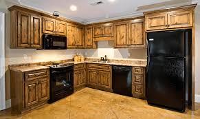 black countertop with black sink oak kitchen cupboards dark brown wooden kitchen table plain