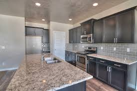 espresso cabinets grey subway tile back splash and granite