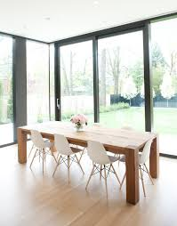 wooden dining table with white chairs zenboa