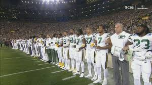 Packer Flags Packers Players Joined By Fans In Linking Arms During National