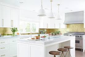 white kitchen with gold leaf backsplash contemporary kitchen