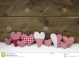handmade red white checked hearts on a wooden christmas backgrou