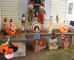 halloween fall front porch yard decorating idea with dry trees