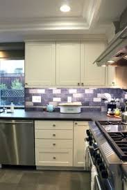 purple kitchen backsplash eclectic purple kitchen mosaic tiles omg a backsplash of this in
