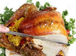 carving a roast turkey for or thanksgiving stock photo