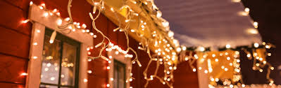 how to hang christmas lights on gutters how to hang outdoor christmas lights robert dyas