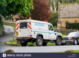 land rover water severn trent water white land rover van parked on the roadside in