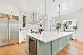 green kitchen cabinets with white island 9 kitchen islands that look gorgeous in green