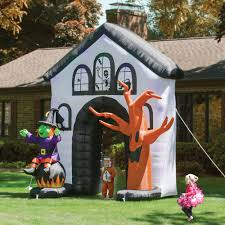 the inflatable howling haunted house hammacher schlemmer