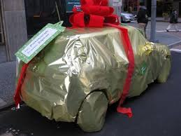 car wrapped in wrapping paper just in time for christmas here s a primer on how to gift