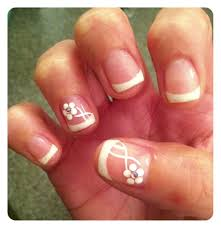 french gel manicure with sparkly tips and amazing rhinestone