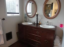 Small Sinks And Vanities For Small Bathrooms by Bathroom Blue Paint Wall With Vanity Sconces And Black Glacier