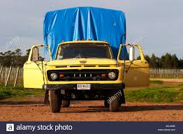 ford truck blue an old ford truck yellow with the doors open and with a bright