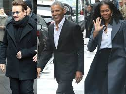 the obama s obamas dine with bono in nyc receive standing ovation