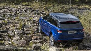orange range rover svr range rover sport svr goes 0 62 mph in 5 5 sec on grass and sand
