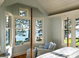 painting knotty pine paneling beach style bedroom whitten