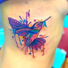 large and small hummingbird tattoos