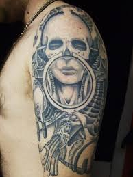 alien woman bones tattoo on arm photos pictures and sketches
