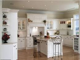 white kitchen cabinets with black countertops four wooden dining