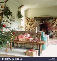 Rustic Wooden Bench Christmas Presents On Rustic Wooden Bench Behind Sofa In Living