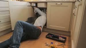 How To Repair Kitchen Sink Repairing A Kitchen Sink Stock Footage