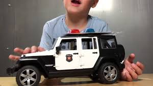 police jeep bruder toy kid videos bruder police jeep wrangler unboxing youtube