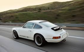 911 porsche cost singer 911 vs eagle e type choose your weapon
