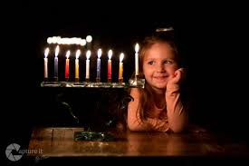 chanuka candles looking into the future child menorah chanukah candles light