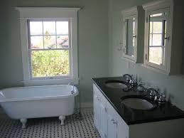 traditional full bathroom with clawfoot bathtub u0026 double sink in