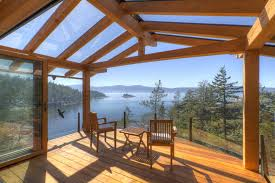 cantilevered deck exterior design wood furniture with glass covered deck and
