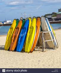sandy beach color kayaks based on stand in background beautiful