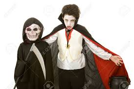 grim reaper halloween costume kids two boys dressed for halloween as a vampire and the grim reaper