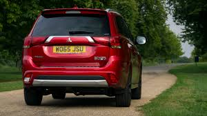 red mitsubishi outlander newmotoring the mitsubishi outlander phev a different kind of hybrid