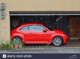 red volkswagen beetle a bright red vw beetle stock photo royalty free image 60194715