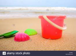 red beach bucket full sand stock photos u0026 red beach bucket full