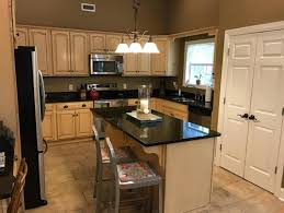 need paint color ideas for kitchen with buttercream cabinets